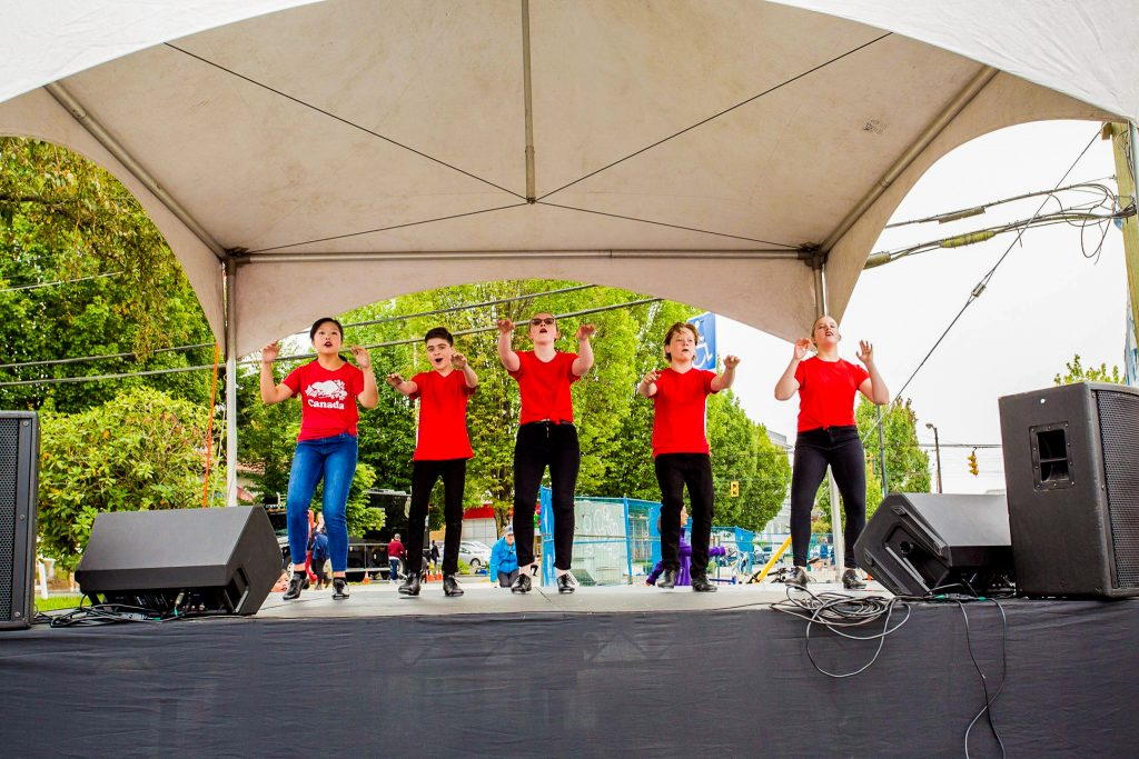 youth tap ensemble outside in red shirts